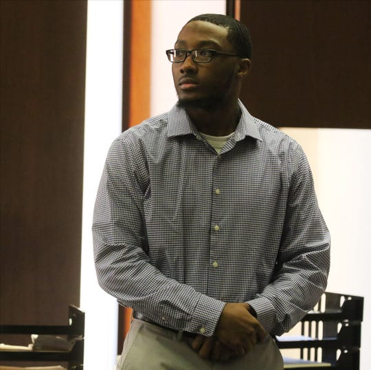 Khalil Wheeler-Weaver of Orange looks back to the gallery as the jury exits the courtroom following closing arguments in the Essex County Courthouse in Newark on December 18, 2019. Wheeler is on trial for the murdering three women and attempting to kill a fourth.