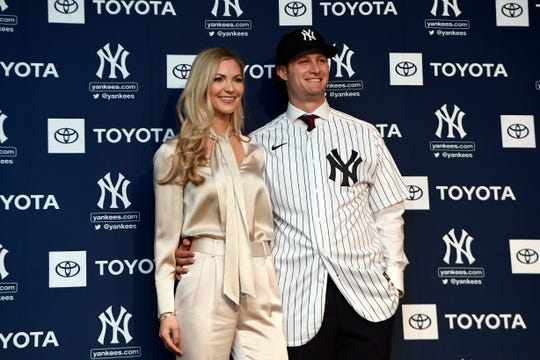 New Yankees pitcher Gerrit Cole poses for photos with wife Amy Crawford at Legends Club at Yankee Stadium.