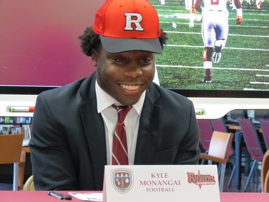 Don Bosco running back Kyle Monangai signs his letter of intent to Rutgers in Ramsey on Wednesday, Dec. 18, 2019.