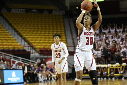 New Mexico State senior Gia Pack (30) attempts a free throw during the Aggies' 70-47 loss to Arizona State on Wednesday at the Pan American Center.