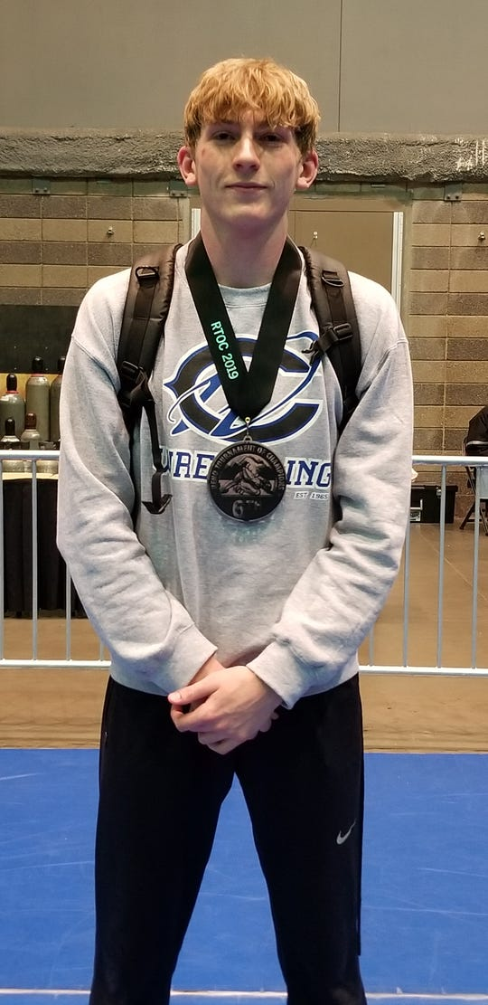 Carlsbad senior Mason Box displays his sixth-place medal at the Reno Tournament of Champions. Box went 4-3 in the tournament against 68 wrestlers from all over the country.
