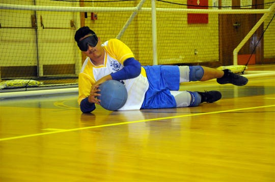 Pedro Garcia in the defensive Position during the New Mexico School for the Blind and Visually Impaired goalball match against Colorado School for the Deaf and Blind Dec. 13.