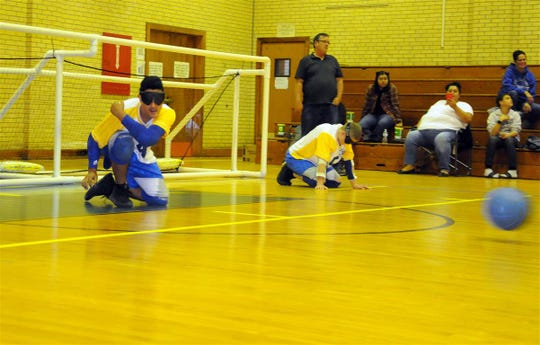 Pedro Garcia rolls the ball during the New Mexico School for the Blind and Visually Impaired goalball match against Colorado School for the Deaf and Blind Dec. 13.