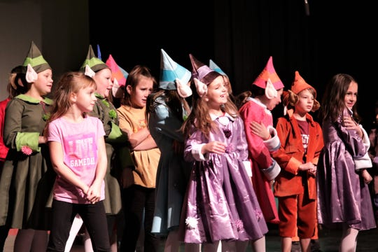 """A group of elves gathers onstage during a rehearsal for the Heather McGaughey Youth Theatre production of """"Elf Jr., the Musical."""""""