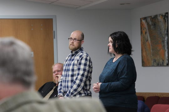 Director of Exceptional Programs for Aztec Municipal Schools Jonathan Acrai, left, and Health Coordinator of Exceptional Programs for Aztec Municipal Schools Erin Raykiewice, right, discuss the district's medical cannabis policy at a school board meeting in Aztec on Dec. 17, 2019.
