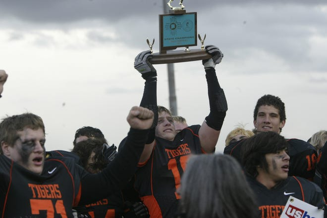 The Aztec Tigers won a state football title in 2011, their first championship since 1953.