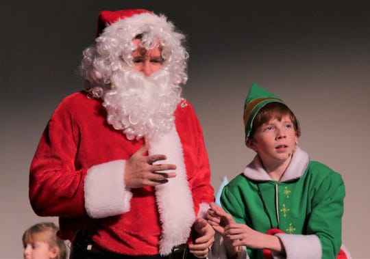 """Eric Liese, left, and Parker Buttrey rehearse a scene from the Heather McGaughey Youth Theatre production of """"Elf Jr., the Musical"""" opening this week at the Farmington Civic Center."""