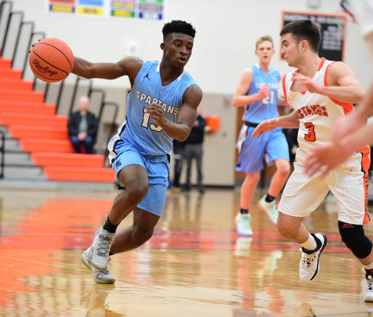 Stevenson's Evan Asante drives to the basket against Northville's Domenic Rodriguez.