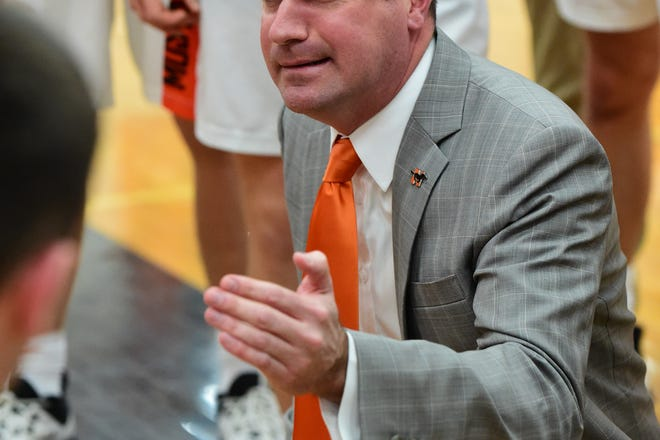 Northville basketball coach Todd Sander talks to his team during a timeout.