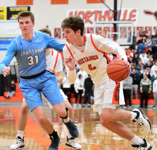 Northville's Zach Shoemaker takes it to the hoop against Stevenson's Ethan Young.