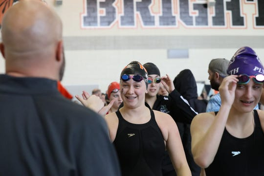 Northville swimmer Emily Roden (center) has become one of the area's best swimmers, even though she's just a freshman.