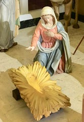 The artistry of the Oberammergau wood carvers shows in the Mary figure. Her facial features and hands have the intricate details. The carved Baby Jesus will appear in the manger on Christmas Eve.