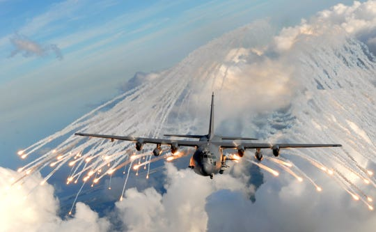 An AC- 130U gunship from the 4th Special Operations Squadron jettisons flares over an area near here, Aug. 24. The flares are a counter measure for heat seeking missiles that may be aimed at the planes real-world missions.