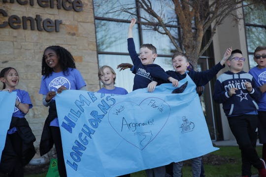 Wilmeth Elementary students greet the UWF football team upon its arrival at the team hotel in McKinney, Texas on Dec. 18, 2019.