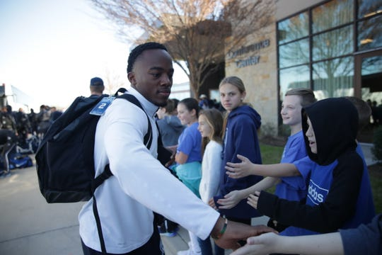 Students greet UWF receiver Rodney Coates upon his arrival at the team hotel in McKinney, Texas on Dec. 18, 2019.