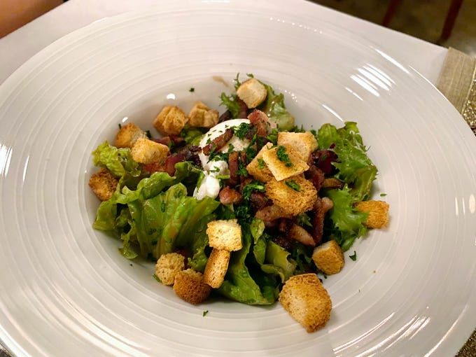 Salade aux lardons with croutons and poached egg at Voila French Bistro in Scottsdale.
