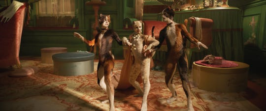 """Rumpleteazer (Naoimh Morgan), Victoria (Francesca Hayward) and Mungojerrie (Danny Collins) in """"Cats,"""" co-written and directed by Tom Hooper."""