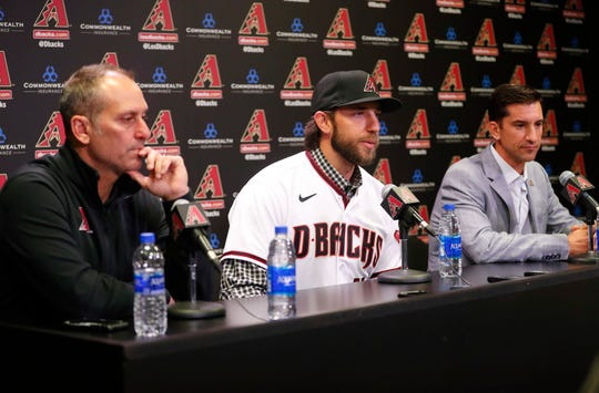 Madison Bumgarner is introduced to the media by Arizona Diamondbacks manager Torey Lovullo (left) and general manager Mike Hazen during a news conference at Chase Field December 17, 2019. Bumgarner signed a five-year deal with the Arizona Diamondbacks.