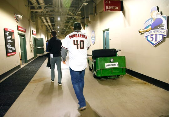 Madison Bumgarner walks in the halls of Chase Field after an introductory news conference December 17, 2019. Bumgarner signed a five-year deal with the Arizona Diamondbacks.