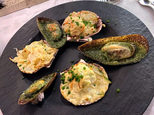 Moules with parsley butter and garlic and petoncles with hollandaise sauce at Voila French Bistro in Scottsdale.