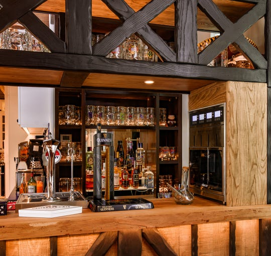 This bar is made of reclaimed wood from an ash tree that once stood on the property.