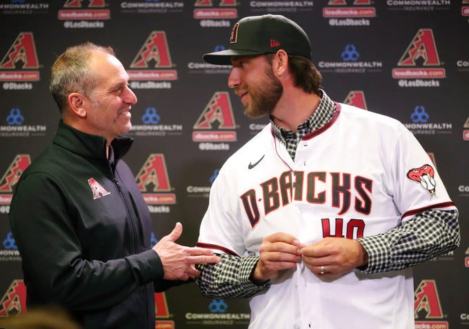 Madison Bumgarner is introduced to the media by Arizona Diamondbacks manager Torey Lovullo during a news conference at Chase Field December 17, 2019. Bumgarner signed a five-year deal with the Arizona Diamondbacks.