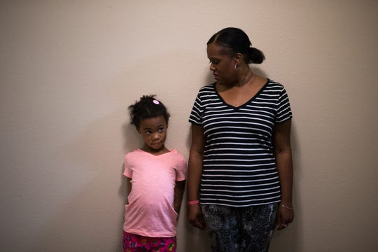 """A portrait of Aliyah Randle and her mom, Laurell Florence, in their new Tempe apartment on Jan. 22, 2016. """"We're home, baby,"""" Laurell says. """"We're home."""""""
