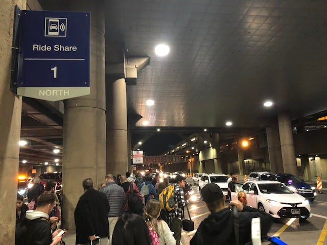 Crowds outside the 1 North Ride Share pickup location at Sky Harbor Airport on Nov. 30, 2019.