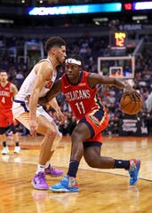 New Orleans Pelicans guard Jrue Holiday (11) controls the ball against Phoenix Suns guard Devin Booker in the second half at Talking Stick Resort Arena earlier this season.