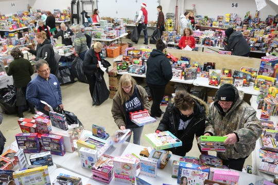 Thanks to the efforts of about 60 volunteers, the local Salvation Army's Toys for Tots distribution will put presents under the tree for over 1,000 Ottawa County children.