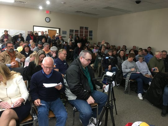 Citizens pack the Clay Township Hall during a meeting about high water levels and ferry rates in Clay Township on Dec. 18, 2019.