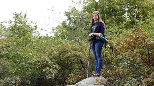 Emily Stoll, a member of the New York State Young Birders Club, is shown birding at Fahnestock State Park.