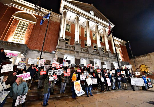 Activists stand together on the steps of the York County Administrative Center during the Nobody is Above the Law Rally in York City, Tuesday, Dec. 17, 2019. Dawn J. Sagert photo