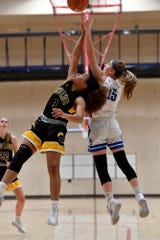 Asia Eames of Red Lion and Spring Grove's Lexi Hoffman battle for a rebound under the Rockets basket, Tuesday, December 17, 2019.John A. Pavoncello photo