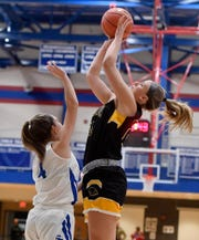 Red Lion's Julia Beiler, right, goes up and over Addyson Wagman of Spring Grove to score, Tuesday, December 17, 2019.John A. Pavoncello photo