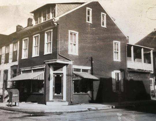 The Freireich family store at the corner of Duke and Maple streets (probably around the late 1940s). The roll-up awnings over the display windows prevented the merchandise from being faded by the sun.