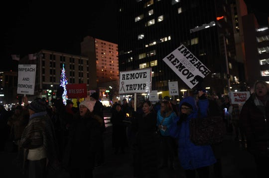 A crowd of about 200 people gather in Reno's City Plaza to demonstrate in favor of impeaching President Donald Trump on Dec. 17, 2019.