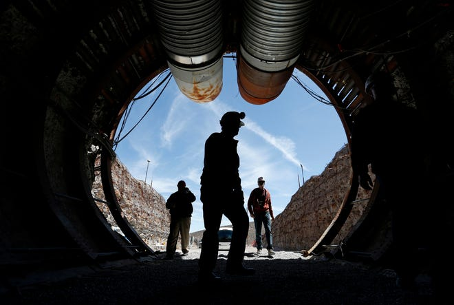 "People walk into the south portal of Yucca Mountain during a congressional tour of the proposed radioactive waste dump near Mercury, Nev., 90 miles northwest of Las Vegas, in 2015. Nevada is branding federal shipments of weapons-grade plutonium to the state a year ago as a ""secret ... smuggling operation,"" and urging a U.S. District Court judge in Reno to reject a bid to dismiss a lawsuit because the Energy Department has already promised no more material will be brought to the state."