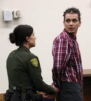 Defendant Lucas Cuellar, right, looks back at his family after being sentenced to prison time during his sentencing hearing at the Second Judicial District Court in Reno on Dec. 18, 2019.