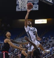 Nevada's Jalen Harris drives to the basket while taking on Cal State East Bay during their basketball game at Lawlor Events Center in Reno on Oct. 19, 2019.