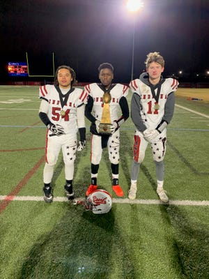 Kevin Handley Jr. (left), Jayden Shipp (middle), and Derrick Lamb (right) of Dennis Intermediate School helped Team Indiana secure a World Youth Football Championship in Canton, OH last week.