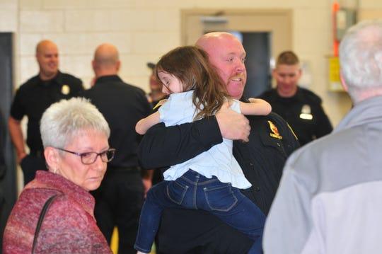 Lt. Joe Buckler hugs niece Sadie Buckler after he was honored as Firefighter of the Year for 2019.