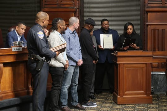 Ramique Hill, Matt Ochs, and Lydell Weatherspoon, the three men who helped save RPD Officer Denny Wright, are flanked by RPD Chief La'Ron Singletary, City Councilman Willie Lightfoot, and Mayor Lovely Warren. The three men were honored Tuesday at Rochester City Hall.