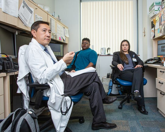 UCLA Alzheimer's and Dementia Care Program Medical Director Zaldy Tan, left, meets with Dementia Care Specialists Kemi Reeves, center, and Michelle Panlilio, right.