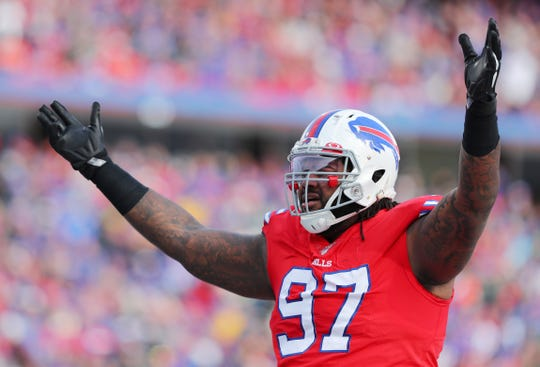 Jordan Phillips of the Buffalo Bills pumps up the crowd during the first half against the Baltimore Ravens on dec. 8 at New Era Field. Phillips has 9.5 sacks this season.