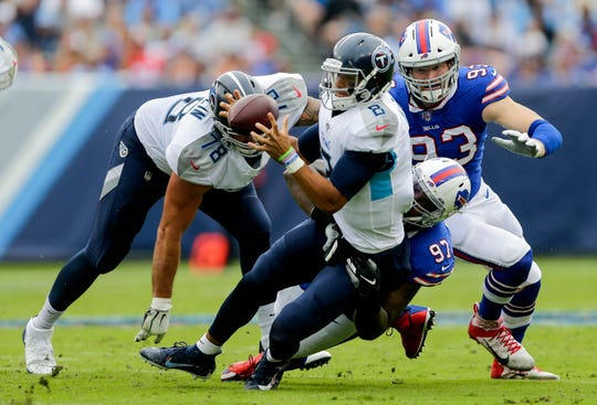 Jordan Phillips of the Buffalo Bills sacks Marcus Mariota of the Tennessee Titans while he looks to pass during the first quarter at Nissan Stadium on Oct. 6 in Nashville.
