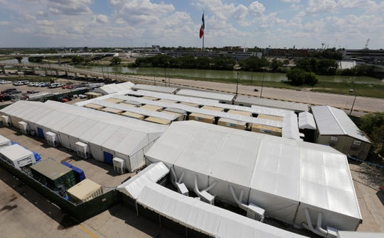 In this Sept. 17, 2019, file photo, is the Migration Protection Protocols Immigration Hearing Facility, a new tent court facility made up of tents and portable pods along the Rio Grande in Laredo, Texas.
