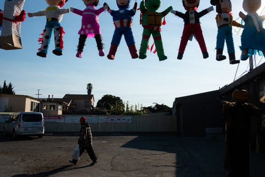 Piñatas hang on display outside Dulceria Vargas, a convent store on Sandborn Road in Salinas.