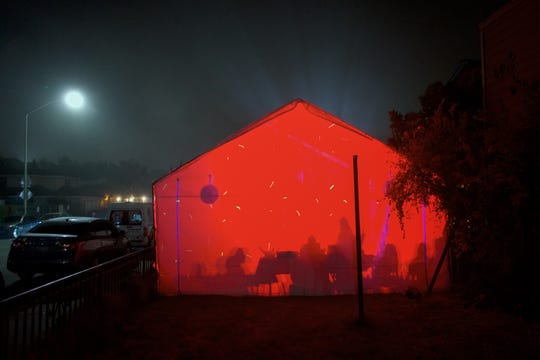 On the East Side of Salinas, families set up a party tent on the weekends. LED lights alternate colors and the sound of Banda music echos throughout the neighborhood.