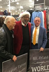 State Sen. Greg Tarver, Caddo Parish D.A. James Stewart and El Dorado Casino VP and GM Robert Urland share a laugh at the fourth annual bicycle give-away at Academy Sports Wednesday, December 18, 2019.